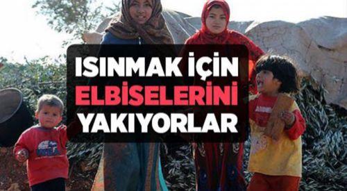 Çadırlarda kalan göçmenler ısınmak için giysilerini yakıyor